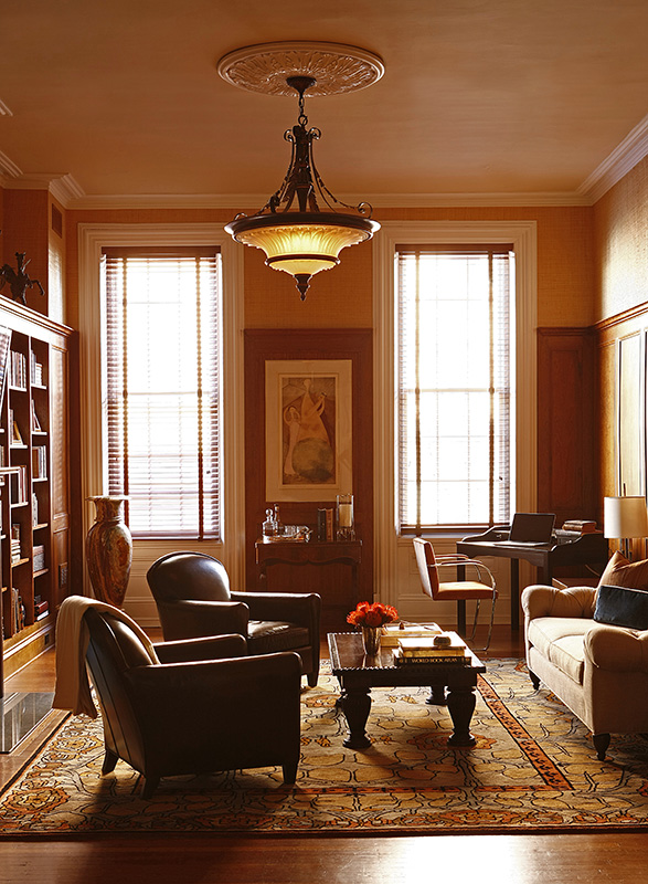 luxurious, authentic, historic renovation, lifestyle, tropical lighting, bookcase and club chairs, create an environment